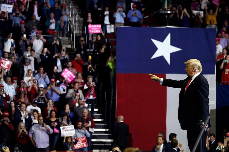 President Donald Trump points into the crowd during a campaign rally for Sen. Ted Cruz, R-Texas, at Houston Toyota Center, Oct. 22, 2018, in Houston.