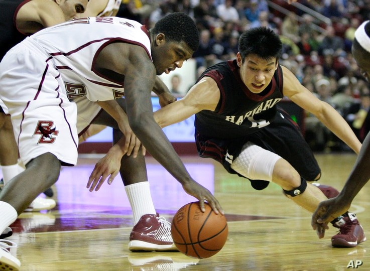 Jeremy Lin, right, playing college basketball for Harvard in an NCAA basketball game in Boston, Dec. 9, 2009.