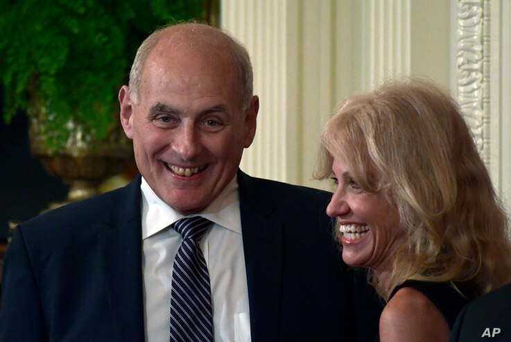 White House chief of staff John Kelly, left, and White House counselor Kellyanne Conway laugh before the start of a news conference with President Donald Trump and Italian Prime Minister Giuseppe Conte in the East Room of the White House in Washingto...