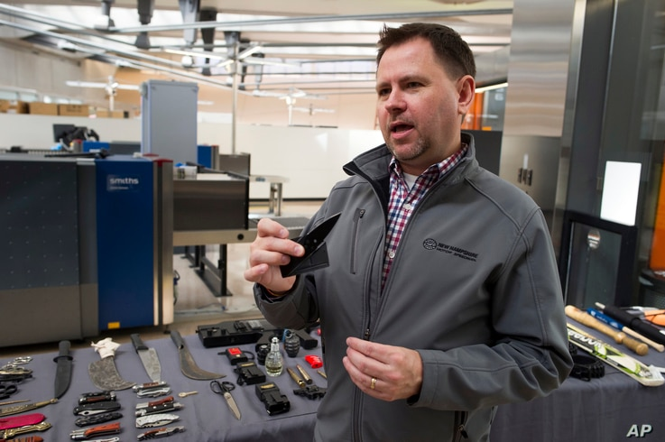 David Johnston, TSA's social media director, displays a knife which was confiscated from a passenger, at Dulles International Airport in Dulles, Va., March 26, 2019.