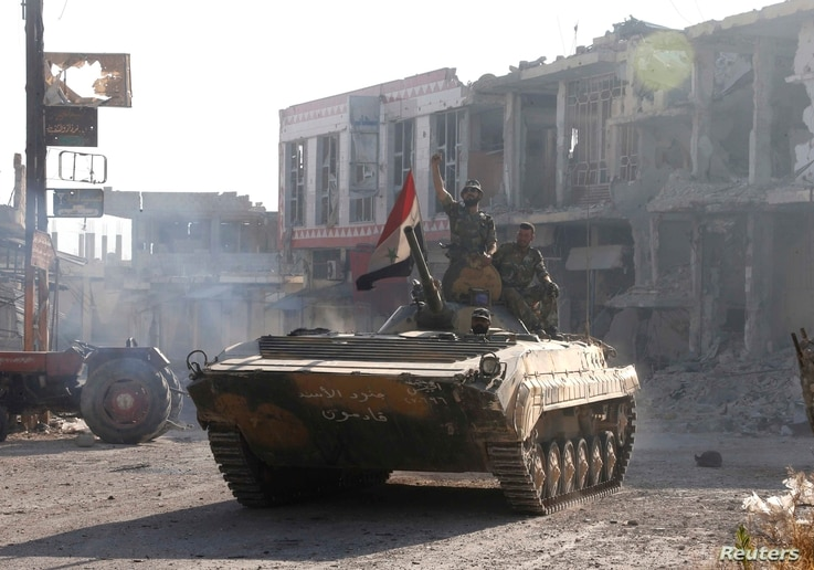 Syrian troops roll into the center of Qusair June 5, 2013, after capturing the stragegic town with key help from Lebanese Hezbollah fighters.