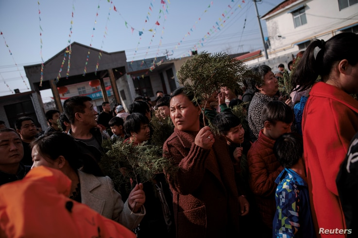 Believers enter the government-sanctioned Catholic church during a mass on Palm Sunday in Youtong village, Hebei province, China, March 25, 2018.