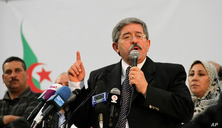 FILE - Algerian Prime Minister Ahmed Ouyahia speaks during a meeting the National Democratic Rally in Algiers, May 5, 2012.
