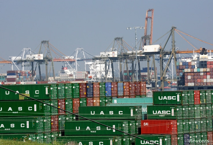 FILE - Cargo containers sit idle at the Port of Los Angeles as a back-log of over 30 container ships sit anchored outside the Port in Los Angeles, California, February 18, 2015.
