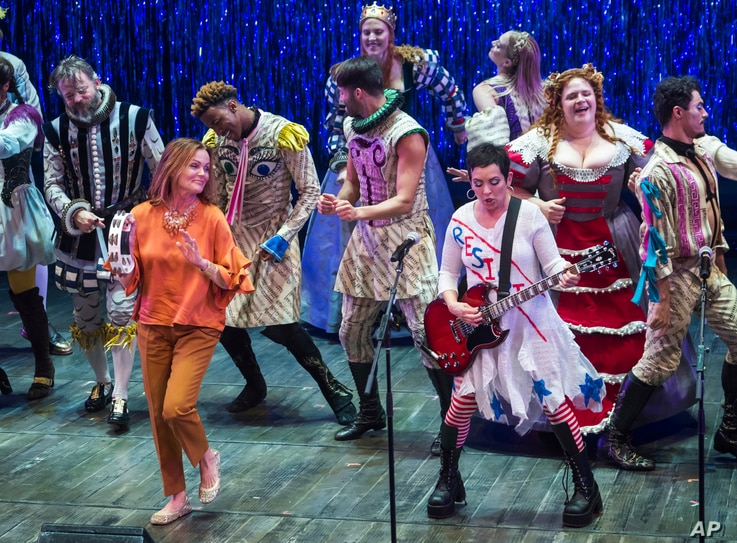 """FILE - The Go-Go's band members, from left, Belinda Carlisle and Jane Wiedlin perform at the curtain call for the Broadway musical """"Head Over Heels"""" in New York, July 12, 2018."""