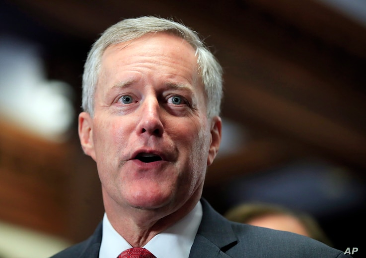 """FILE - Freedom Caucus Chairman Rep. Mark Meadows, R-S.C., speaks to reporters on Capitol Hill in Washington. Divisions over whether to provide a conduit to citizenship for young """"Dreamer"""" immigrants brought to the U.S. illegally loom as the pivot..."""