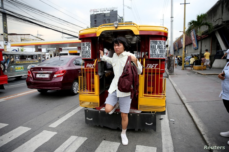 Oliver Emocling, 23, who works for a magazine, gets off a jeepney near his office in Makati City, Philippines, Nov. 29, 2018.