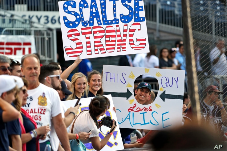 Supporters of House Majority Whip Steve Scalise, R-La., hold signs before the congressional baseball game, June 15, 2017, in Washington. The annual GOP-Democrats baseball game raises money for charity.