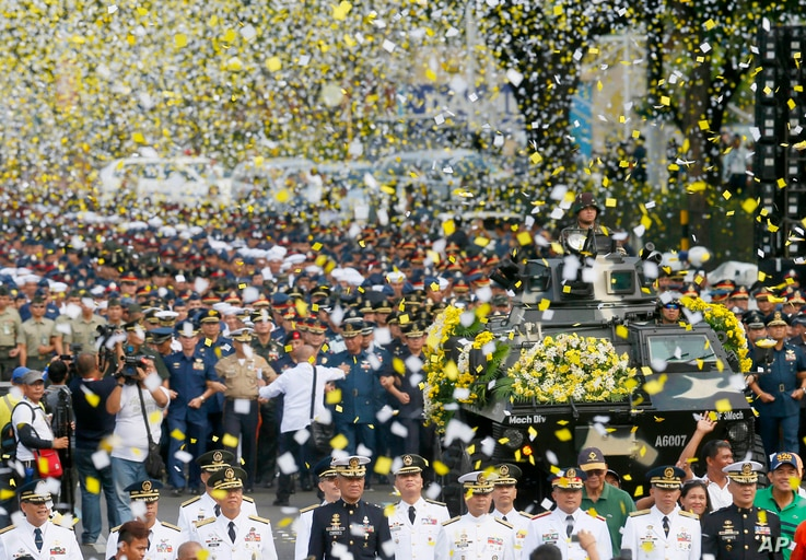 """Yellow confetti rain on the military component during the 30th anniversary celebration of the """"People Power Revolution"""" that toppled the 20-year-rule of the late strongman Ferdinand Marcos and helped install Corazon """"Cory"""" Aquino to the presidency, T..."""