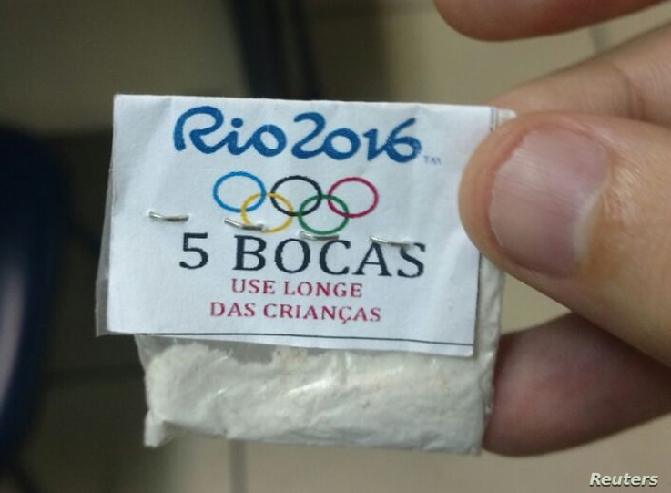 """One of dozens of packages of cocaine stamped with a Rio 2016 label, the Olympic rings, and a warning that reads, """"Keep away from children,"""" confiscated by police in a raid on the Lapa neighborhood of Rio de Janeiro, July 25, 2016."""