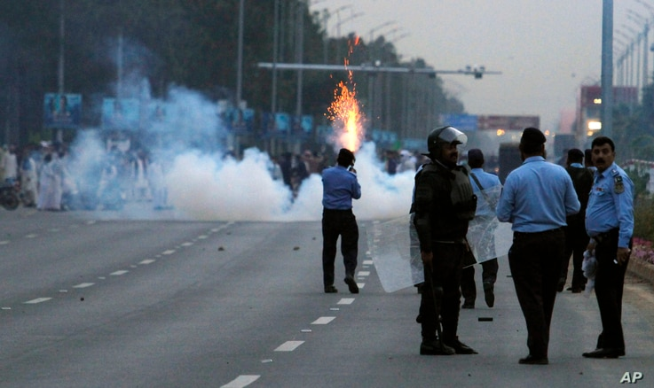 Pakistani police fire tear gas to stop protesters from marching towards the parliament building in Islamabad, March 27, 2016.