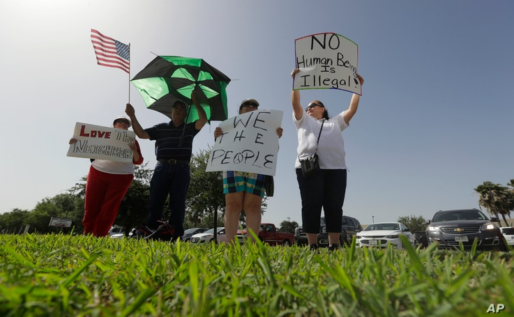 Protesters gather near a U.S. Customs and Border Protection station to speak out against immigration policy, June 30, 2018, in McAllen, Texas.
