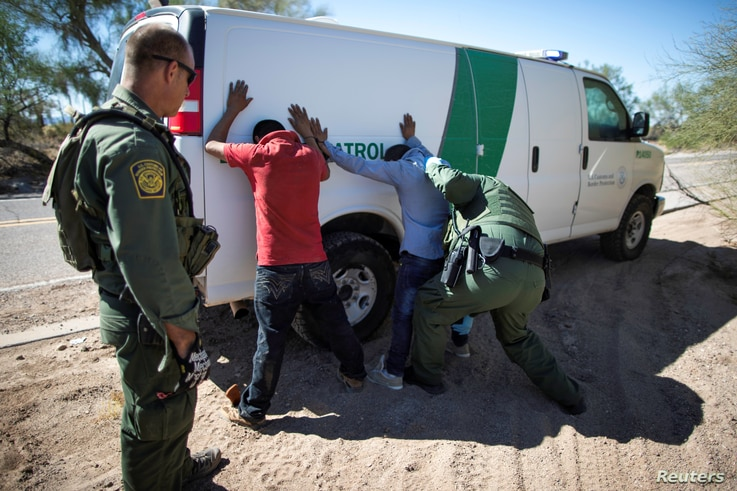 Border Patrol agents arrest migrants who crossed the U.S.-Mexico border in the desert near Ajo, Arizona, Sept. 11, 2018.