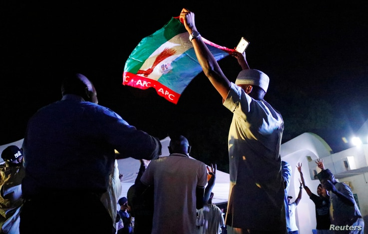 Supporters of Nigeria's President Muhammadu Buhari celebrate at the campaign headquarters of the All Progressives Congress (APC) party in Abuja, Nigeria, Feb. 26, 2019.