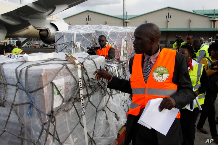 Independent Electoral and Boundaries Commission IEBC officials receive ballot papers for the repeat of the presidential election on Oct. 26, at JKIA airport in Nairobi, Kenya, Oct. 23, 2017.