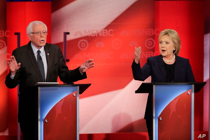 Democratic presidential candidate Senator Bernie Sanders and former Secretary of State Hillary Clinton spar during a presidential primary debate at the University of New Hampshire in Durham, Feb. 4, 2016.