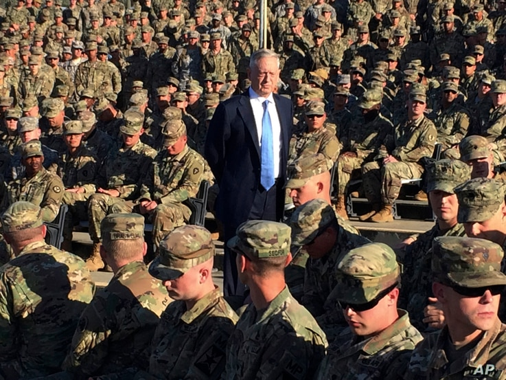 FILE - Defense Secretary Jim Mattis talks to U.S. troops at Guantanamo Bay, Cuba, Dec. 21, 2017.