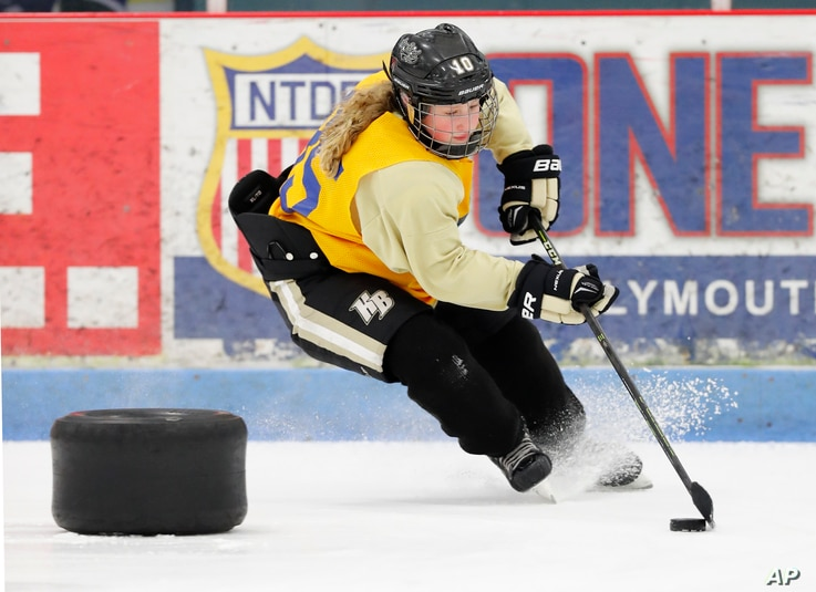 In this March 28, 2017, photo, Crosby Wildfong, 12, skates during practice with the HoneyBaked 12U Tier 1 hockey team, in Farmington Hills, Mich.