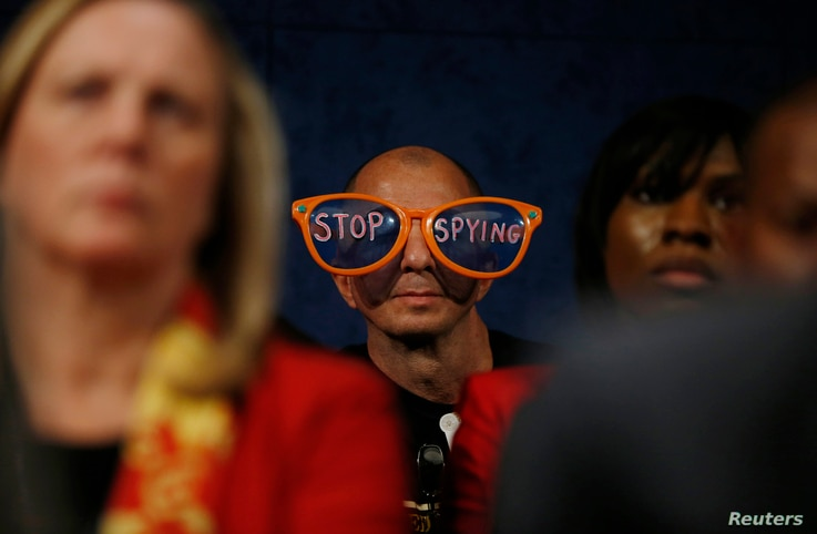 A protester critical of the practices of U.S. security agenices sits in the audience as U.S. top intelligence officials testify on Capitol Hill in Washington, October 29, 2013.