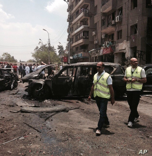 Emergency personnel inspect damage after a bomb attack has targeted Egypt's prosecutor general in the Heliopolis district of Cairo, Egypt, June 29, 2015.