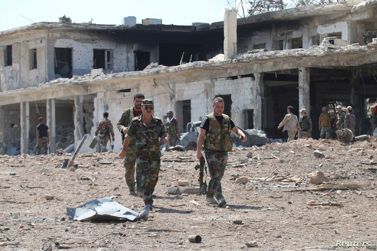 Forces loyal to Syria's President Bashar al-Assad walk at a military complex after they recaptured areas in southwestern Aleppo on Sunday that rebels had seized last month, Syria, in this handout picture provided by SANA on Sep. 5, 2016.