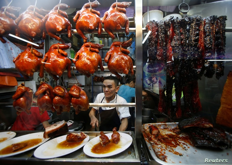 Hawker Chan Hong Meng, who won a Michelin star, sells soya sauce chicken at his Hong Kong Soya Sauce Chicken Rice and Noodle stall at Chinatown food center in Singapore July 22, 2016.