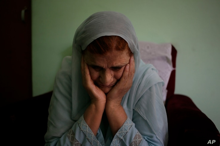 Shamsul Nisa, 80, breaks down as she narrates her story to the Associated Press inside her house in Srinagar, Indian controlled Kashmir, Aug. 5, 2017. Nisa was 10 when she watched her Muslim father, grandfather and six uncles killed by Hindu mobs in ...