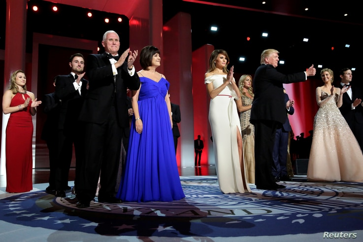 U.S. President Donald Trump with his wife, Melania, and Vice President Mike Pence with his wife, Karen, greet the audience at the  Liberty Ball in Washington, Jan. 20, 2017.