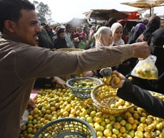 Egyptians shop at a vegetable market in Cairo on February 6, 2011.