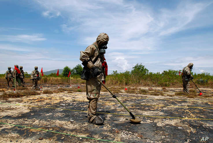 "June 17: Soldiers detect Unexploded Ordnance and defoliant Agent Orange during the launch of the ""environmental remediation of dioxin contamination"" project, in Da Nang City, Vietnam. The U.S. and Vietnam launched the first concrete step toward clean"