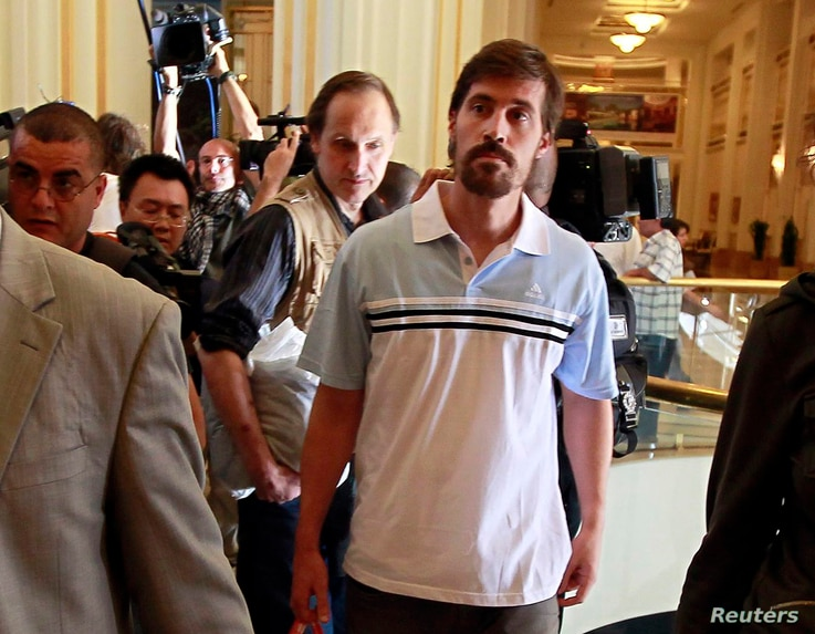 U.S. journalist James Foley (R) arrives with fellow reporter Clare Gillis (not pictured), after being released by the Libyan government, at Rixos hotel in Tripoli, in this picture taken May 18, 2011. Islamic State militants have posted a video that p...