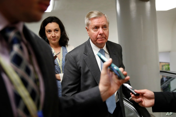 FILE -Sen. Lindsey Graham, R-S.C. is followed by reporters on Capitol Hill in Washington, May 23, 2017 f.
