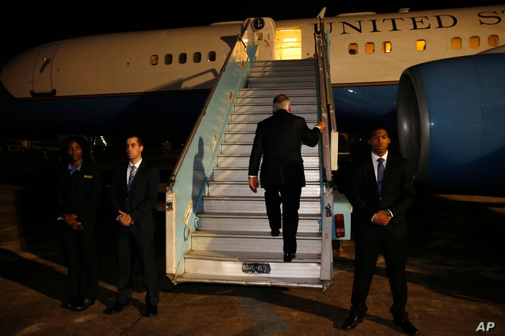 U.S. Secretary of State Rex Tillerson boards his plane to depart at the end of a five-country swing through Africa from Abuja, Nigeria,  March 12, 2018.