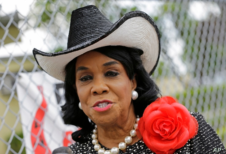 Rep. Frederica Wilson, D-Fla., talks to reporters in Miami Gardens, Fla., Oct. 18, 2017.