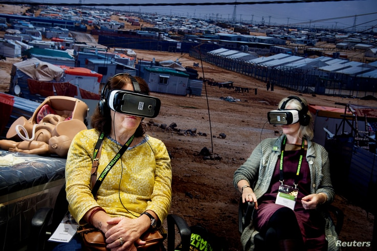 """Participants watch virtual reality movie """"Born into Exile"""", about two pregnant women who are due to deliver in Za'atari refugee camp, Jordan, during Women Deliver, a major women's health and rights conference in Copenhagen, Denmark, May 17, 2016."""