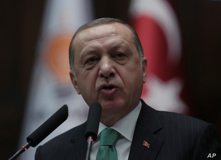 Turkey's President and leader of ruling Justice and Development Party Recep Tayyip Erdogan addresses the members of his ruling party at the parliament in Ankara, Turkey, Tuesday, Feb. 13, 2018.