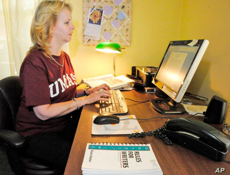 FILE -- Laurel Ranticelli looks at her University of Massachusetts online class information at her home in Springfield, Mass.