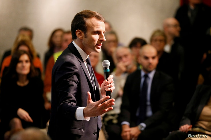 "FILE - French President Emmanuel Macron attends a meeting with local residents as part of the ""Great National Debate"" in Bourg-de-Peage near Valence, France, Jan. 24, 2019."