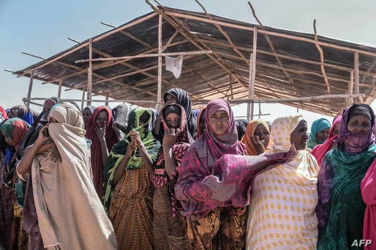 FILE - People gather for a food distribution at the Farbudo internally displaced person camp, in Gode, near Kebri Dahar, southeastern Ethiopia, Jan. 27, 2018.