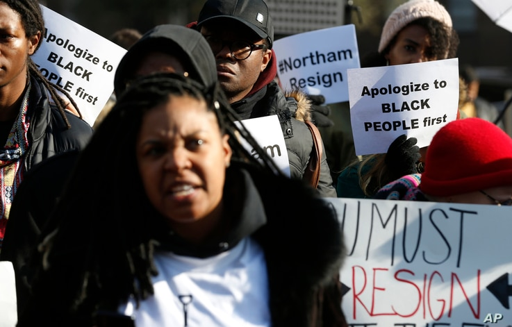 Demonstrators hold signs and chant outside the Governor's Mansion at the Capitol in Richmond, Va., Feb. 2, 2019. The demonstrators were calling for the resignation of Virginia Gov Ralph Northam after a decades-old, racially insensitive photo from his