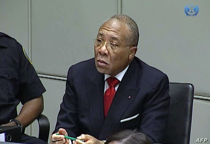 Former Liberian President Charles Taylor appearing in court at the Special Court for Sierra Leone in Leidschendam, January 22, 2013.