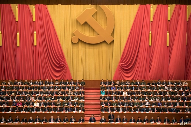 In this Oct. 18, 2017, file photo, Chinese President Xi Jinping, center, presides over the opening ceremony of the 19th Party Congress held at the Great Hall of the People in Beijing.
