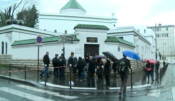 Muslims gathers outside a Paris mosque following the November 2015 terrorist attacks.