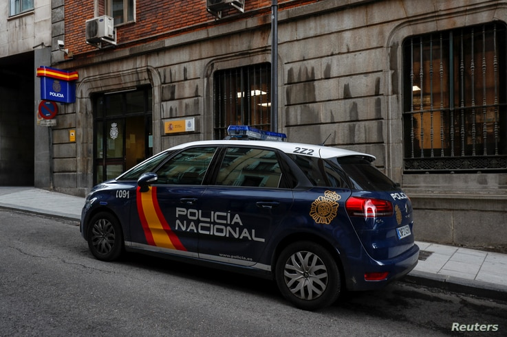 FILE - A police car is seen outside the police station where British businessman Bill Browder, a prominent critic of Russian President Vladimir Putin, was taken to when he was detained and then released by Spanish police in Madrid, May 30, 2018.