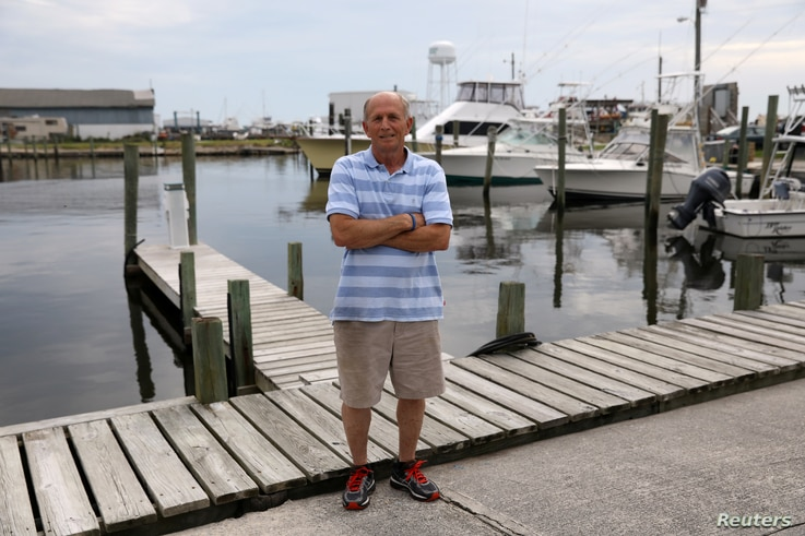 Mikey Daniels poses in Wanchese, North Carolina, May 31, 2017.