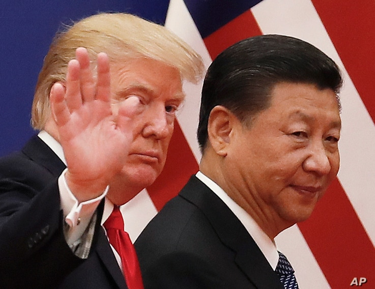 FILE - Chinese President Xi Jinping walks with U.S. President Donald Trump, Nov. 9, 2018, after attending a business event at the Great Hall of the People in Beijing. Xi promised tax cuts and other help to China's entrepreneurs in a renewed effort to...