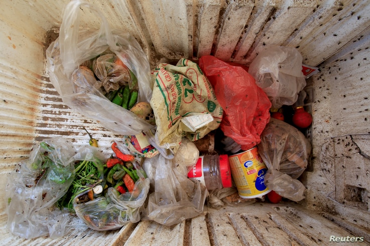 Food is stored in a broken refrigerator belonging to 18-member Ruzaiq family who live next to a garbage dump where they collect recyclables and food near the Red Sea port city of Hodeidah, Yemen, Jan. 16, 2018.