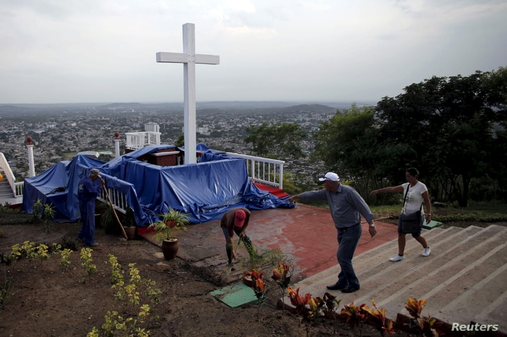 Workers clean the Loma de la Cruz, a day before Pope Francis' visit to Holguin in Cuba, Sept. 20, 2015.