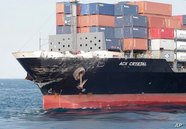 In this photo released by Japan's 3rd Regional Coast Guard Headquarters, the damage of Philippine-registered container ship ACX Crystal is seen in the waters off Izu Peninsula, southwest of Tokyo, after it had collided with the USS Fitzgerald, June 1...