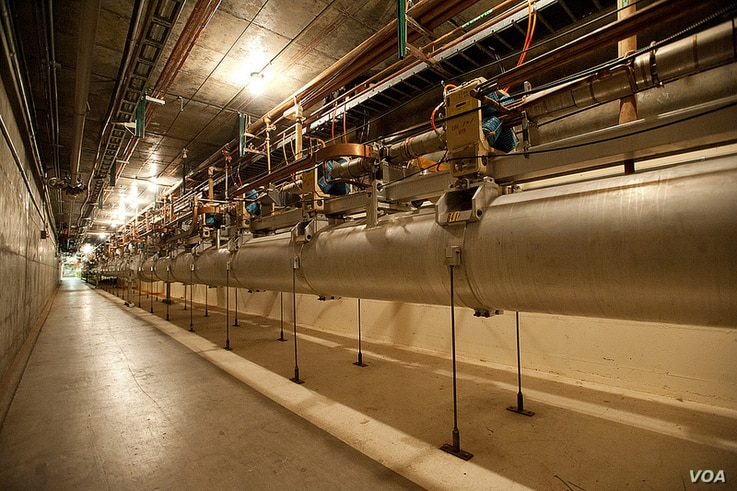 Inside the SLAC National Accelerator Laboratory's linear particle accelerator. It consists of 3.22 kilometers of copper cavities, 25 feet underground that use radio waves to push electrons and their antiparticles, positrons, to high energies, nearly ...